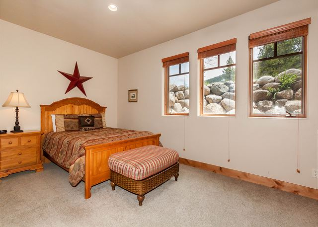 The third guest bedroom is downstairs and has a queen-sized bed.
