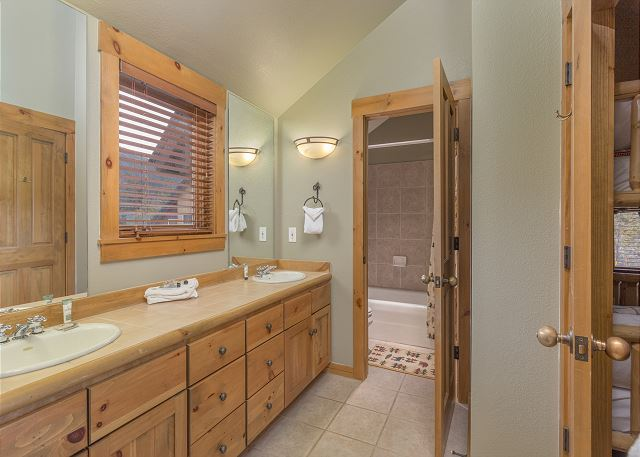 The upstairs guest bedrooms share a jack-and-jill bathroom.