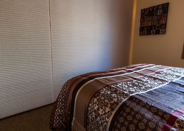 The sleeping quarters can be separated from the rest of the living space with a room divider.