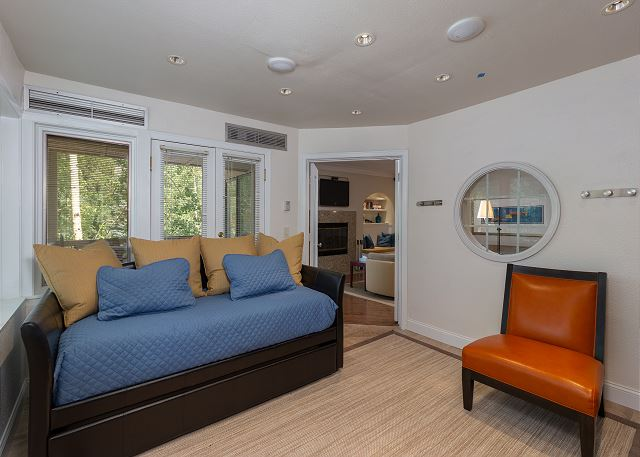 The third guest bedroom is off the main living area and features a twin-sized day bed with a trundle. It also has its own entrance to the main balcony.