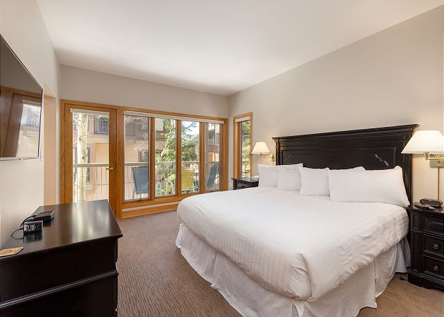 The master bedroom features a king-sized bed, a flat screen TV and its own private balcony.