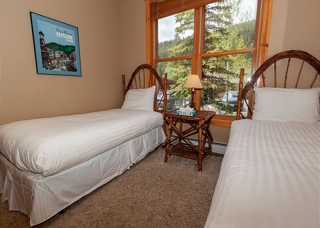 The guest bedroom has two twin-sized beds.