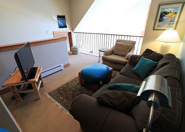 Upstairs loft with sleeper sofa and flat screen TV.