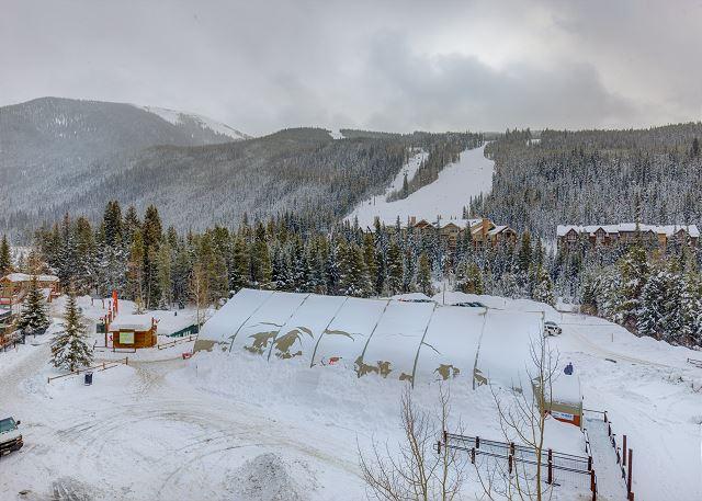 The loft balcony features beautiful ski slope views.