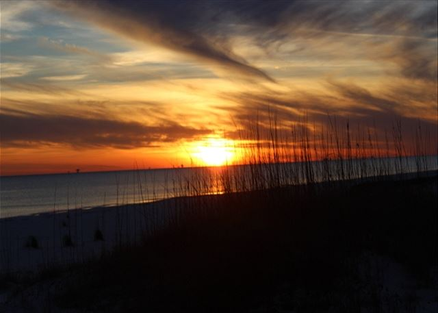 A beautiful sunset over the gorgeous Fort Morgan beach.