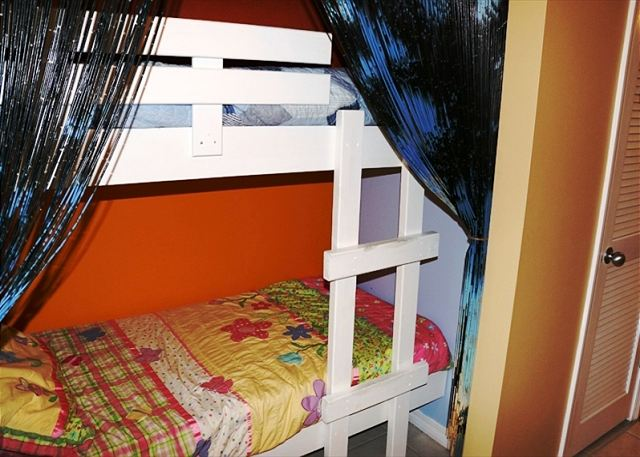 The bunk beds in the hallway.