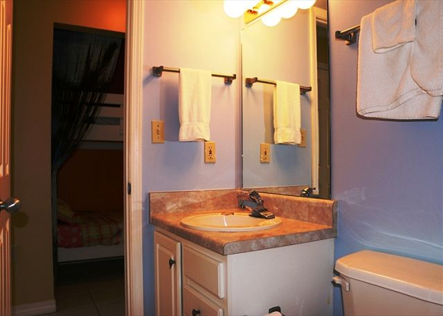 The bathroom across from the bunk beds.