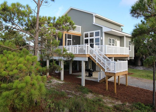 Retreat to Tranquil Bliss, a brand new beach home beautifully furnished and steps to beach or large pool.  New hot tub being added to the open deck outside the porch, end of August 2013.