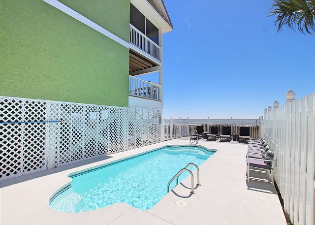 The expansive pool deck with views of the beach and gulf.
