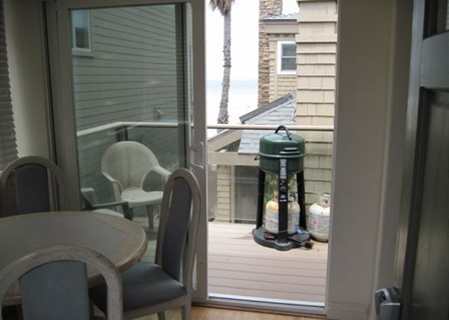 This dining room seats 4 and has access to the balcony with a small view of the ocean and a bbq.
