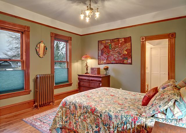 Master bedroom has a comfortable, queen-size bed