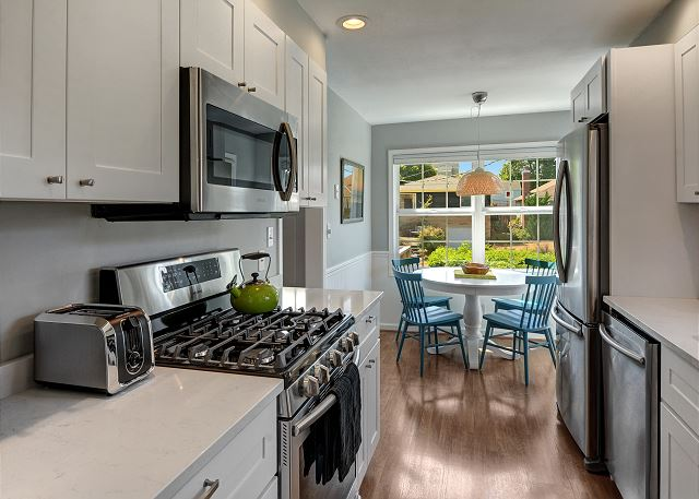 Kitchen is fully equipped with cookware and dishes