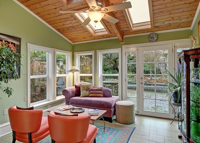 Sun room opens to the back patio and gives even more space to longue
