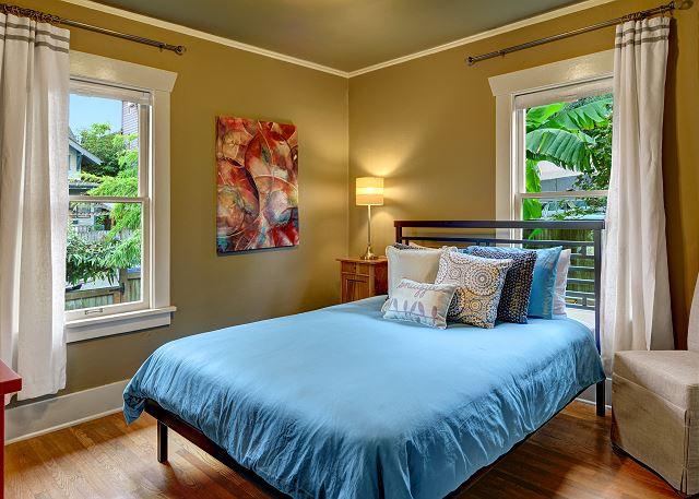 Queen size bed in back bedroom