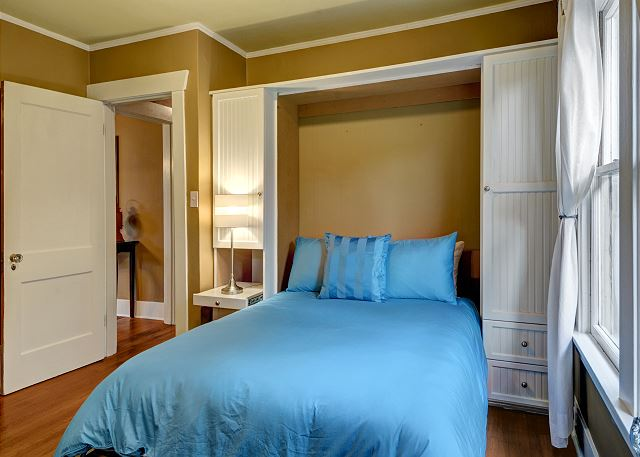 Full size murphy bed is always left open and made up