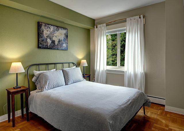 Comfortable queen bed in the peaceful bedroom.