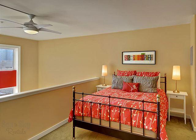 Loft bedroom with queen size bed, en suite bathroom and large closet.