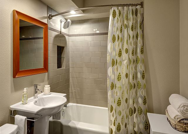 This stylish bathroom with shower/tub combo has everything you need.