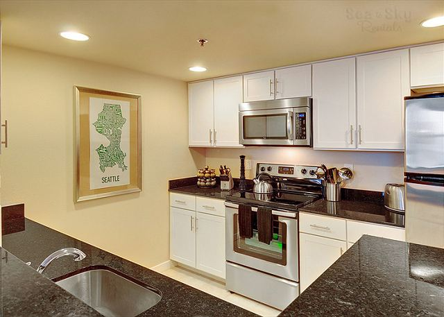 Newly remodeled with granite countertops, tile floors and stainless steel appliances.