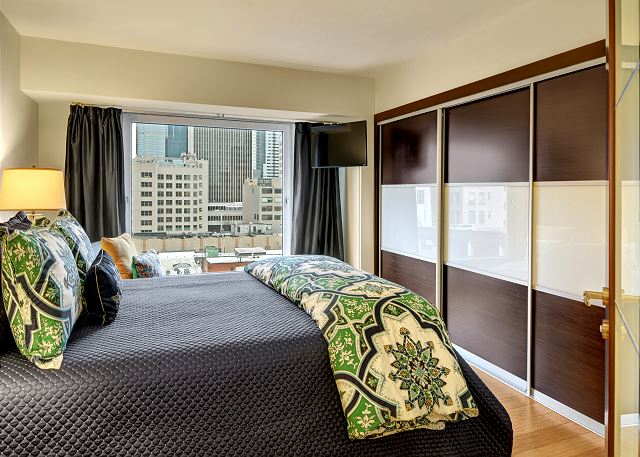 Master suite with city view and en suite bathroom
