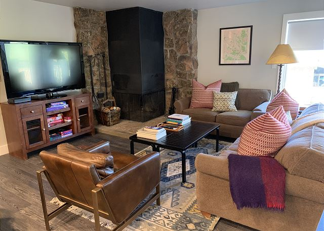 The living room has a wood burning fireplace, large flat screen TV.  Comfy sitting area and games for night time entertaining.