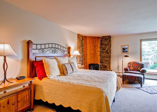 Master bedroom has a king bed, fireplace and a private bathroom.  You can step out doors and on to the slops.