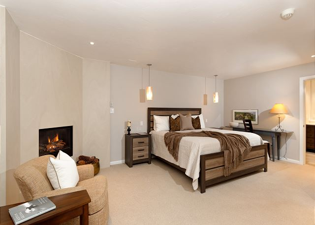 Large master bedroom with a gas fireplace and reading area.  Beautiful private bathroom inside the room.