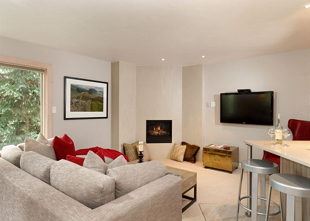 Living Room has plenty of seating to enjoy the gas fireplace and entertaining.  Flat screen TV.