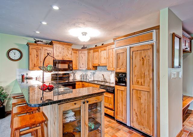 Beautiful kitchen that is stocked with everything you need.