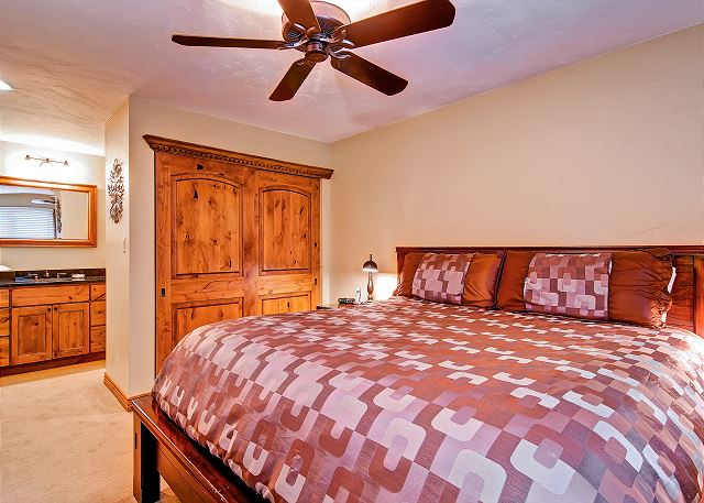 Master bedroom has a king bed with private bathroom.