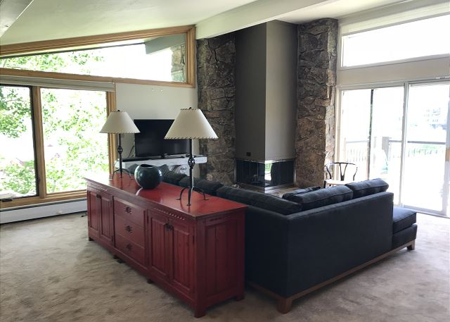 Spacious living area with views to die for.  Flat screen TV, gas fireplace and two over stuffed chairs.