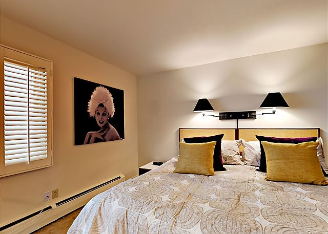 Master bedroom has a king bed and a private full bathroom.