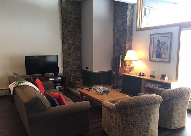 Gas fireplace, flat screen TV and a fabulous view of the mountain range.