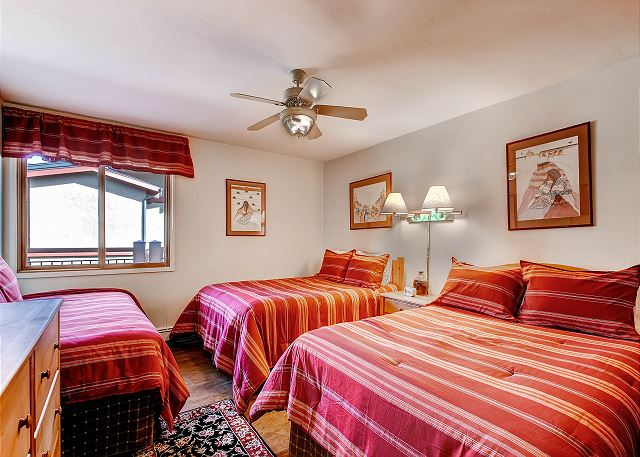 Two Double beds, one twin bed with full bathroom.