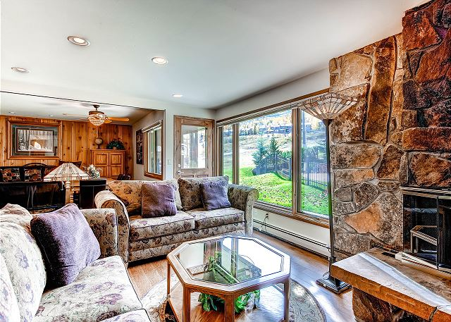 Gas fireplace with a cozy feel. Steps to Fanny Hill and pool area.