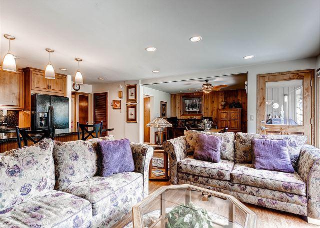 Living room with sleeper den and front door