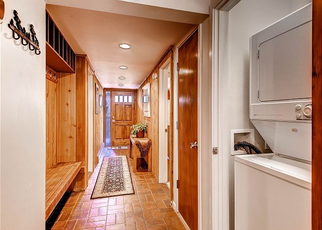 Washer and dryer in closet hallway and entrance