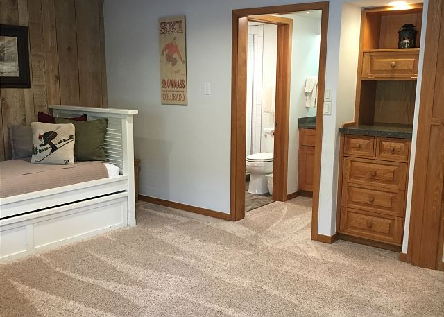 Sleeper den at night and an open living room and kitchen space during the day with plenty of dining space.  The trundle pulls up and provides 2 twin beds during the night.  A wooden wall comes across at night for privacy with a full bathroom inside.