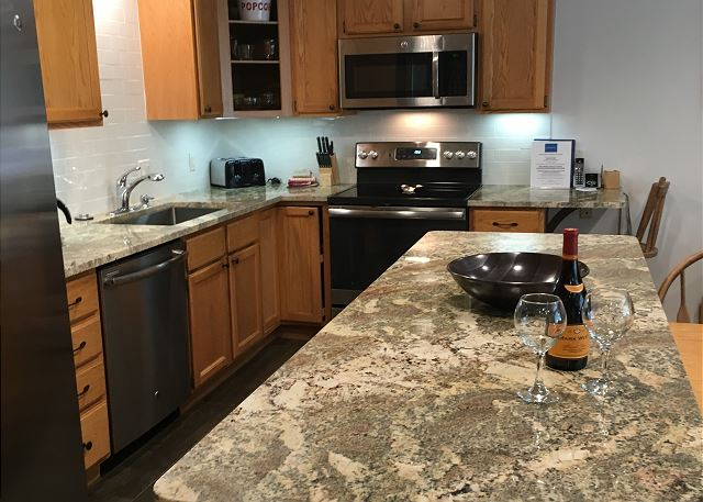 Beautiful kitchen fully equipt with new stainless steel appliances, new counter top and wood flooring.