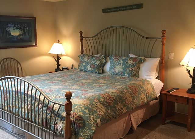 Master bedroom has a king bed and a beautiful updated bathroom.