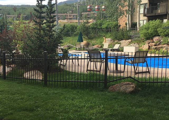 Patio view of pool and hot tubs.  Steps to the slope.  Can't get much closer than this.