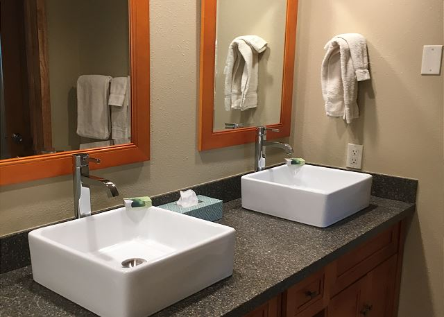 Newly remodeled Master bathroom with double sinks and walk in glass shower.