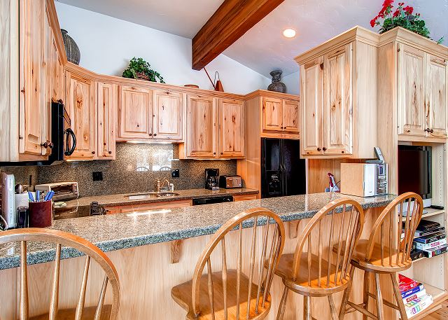 Beautiful kitchen with a nice breakfast bar.
