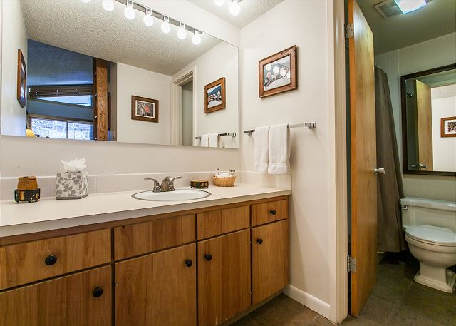 Double vanity and a private door to bathroom.