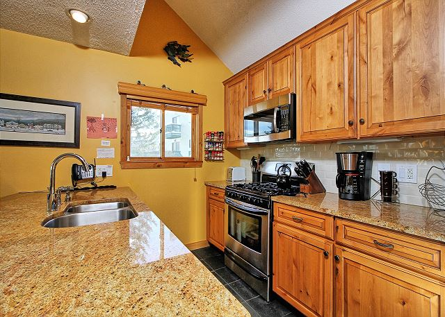 Updated kitchen open to the main floor areas of Trailside 40C at Okemo