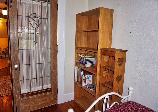 As you enter the twin bedroom to your left are bookshelves