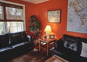 Ambient lighting on where the loveseat corner and couch meet in the living room.