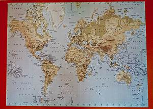 This huge map of the world hangs over the full size couch in the living room
