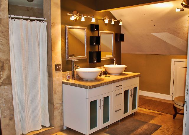 View of the Sinks, shower entry and an alcove at the rear which leads to the restroom facility.