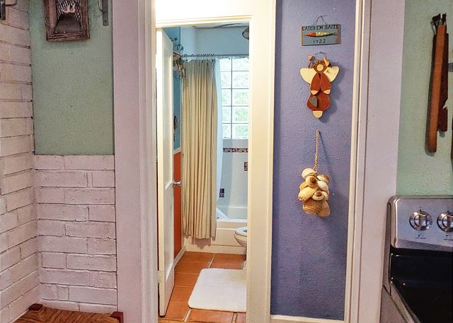 View of the hall and bathroom entrance as you walk through the kitchen doorway